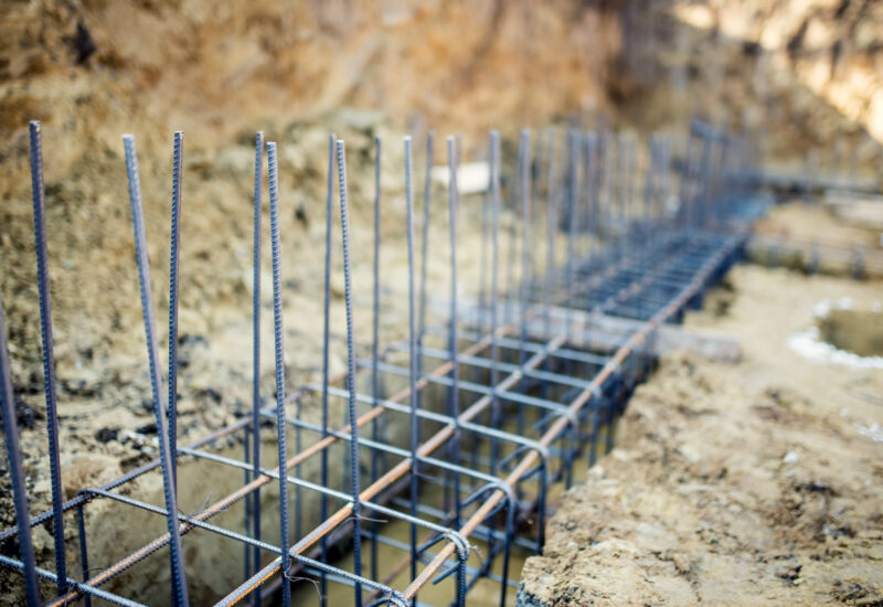 Foundation site of new building, details and reinforcements with steel bars and wire rod, preparing for cement pouring